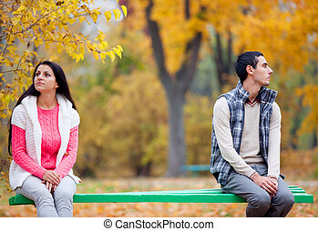 couple at the park in autumn time