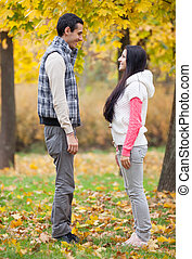 Teen couple at the park in autumn time