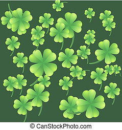 Leaves of clover on a green background