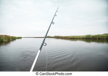 Fishing rod at the calm autumn river