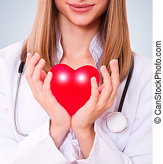 Health insurance or love concept - The doctor holding heart...