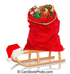 Santas sack on sledge isolated - Santas sack full of gift...