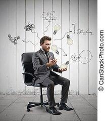 Idea - Concept of businessman that elaborates a new idea