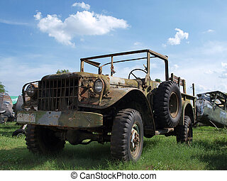 An old military Jeep with missing engine
