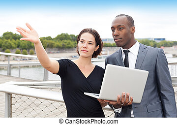 Businesswoman showing something to her collaborator
