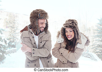 Loving couple outdoors in the snow