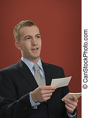 Oral Presentation - Businessman giving a speech using index...