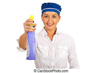 Maid holding cleaning product