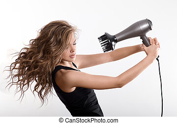 girl dries long hair with hairdryer - attractive girl blows...