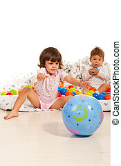 Children playing home with balls