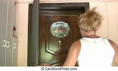 Welcoming - Women opening the door