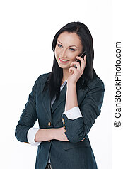 Young business lady talking by phone and smile Standing on...