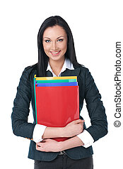Nice businesswoman standing with folders. Front view,...
