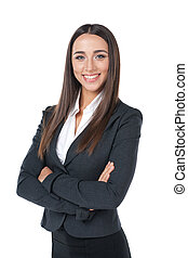 Pleasant businesswoman smiling with hand crossed. Standing...