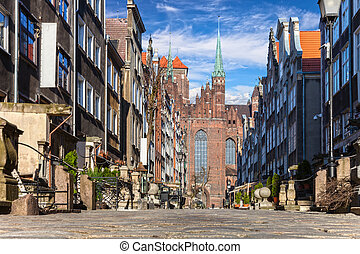 Mariacka Street with the Basilica St Marys in Old Town of...