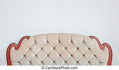 Retro upholstery - A retro bedstead against a white wall