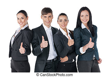Successful business people with thumbs up and smiling. Standing isolated on white