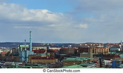 Shadows of clouds borne by city. Gothenburg, Sweden. Time Lapse