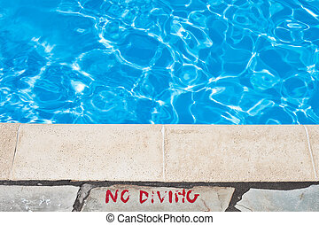 Poolside warming - No diving warning at the edge of a...