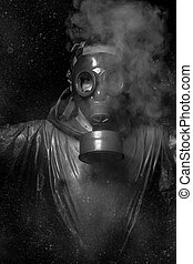 Nuclear attack. A man in a gas mask in the smoke. artistic background