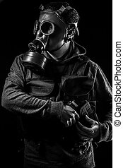 Toxic attack. A man in a gas mask in the smoke. artistic background