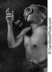 Destruction attack. A man in a gas mask in the smoke. artistic background