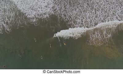 Top view of Surfers - Top view of unidenfied people surfing,...