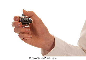 Hand holding a silver pedometer