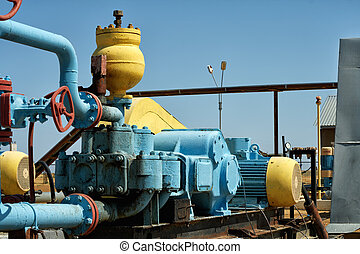Pump pumping oil. - Pump is pumping oil is colored blue,...
