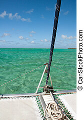 Detail of catamaran with turquise water background -...