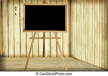 Room with wooden wall and blackboard