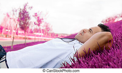 Man portrait lying on the grass.Dreamscape