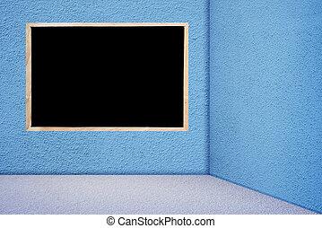 Blackboard in blue room