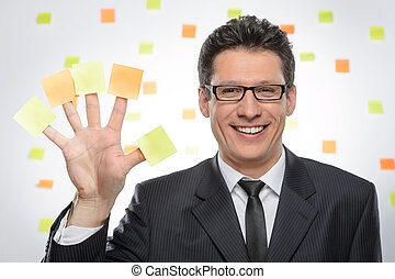 Multi-tasking businessman Portrait of cheerful businessman...