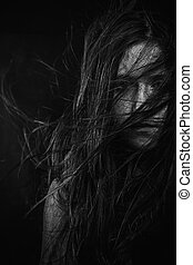 Scary, Portrait of young female beauty with long dark hair...