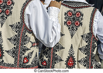 Traditional Romanian folk costume.Detail 32 - Friendship...
