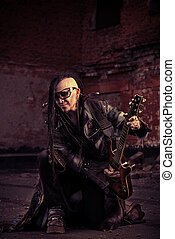 shooting a movie - Modern rock musician playing the guitar...