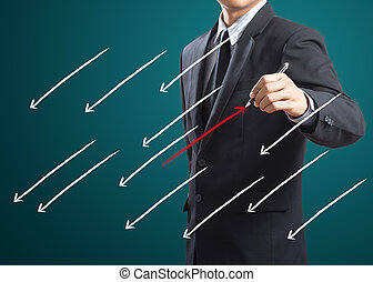 Drawing arrows in different - Businessman drawing arrows in...