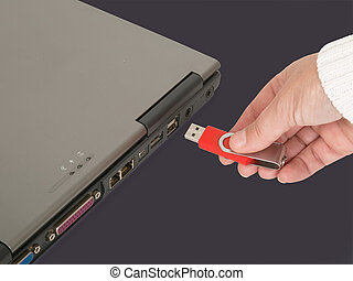 Inserting memory stick - womans hand insert usb memory stick...
