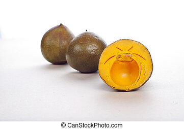 lucuma fruit - delicious and tasty lucuma fruit against a...