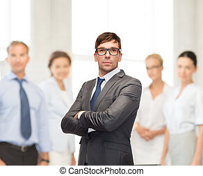 attractive businessman or teacher in glasses - business and...