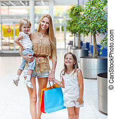 Happy family on shopping in the store - Happy smiling family...