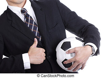 Football manager hold ball for command player for follow as...