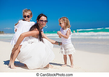 Two wonderful girls having fun with their charming young...