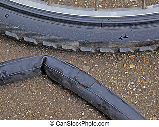 Mending a puncture on a mountain bike - Patch on punctured...