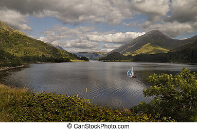 A Loch in the Highlands - A yacht travels, accross the...