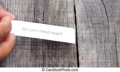 Do you need help - A Do you need help paper sign on wood...