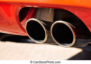 Exhaust Pipe - Close up of a red car dual exhaust pipe