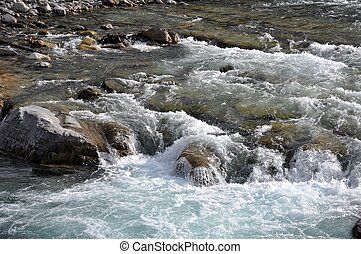 Rapid River Water - Rapid flowing water over rocks on the...