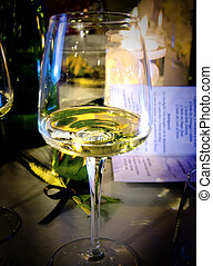 Crystal glass with champagne on the elegant table